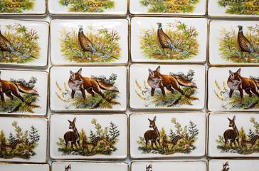 Wild animal motives on handmade porcelain fridge magnets.