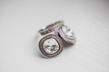 Elegant bridal earrings with wedding ring