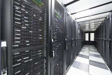 Servers in storage cabinets in data center