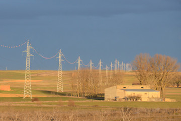 Photo of pillars power lines at sunset