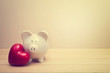 Piggy bank with red heart