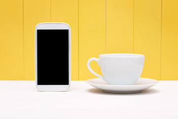 Smart phone with coffee cup