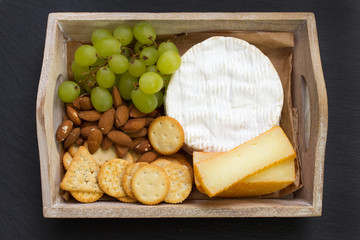cheese with grape and cookies