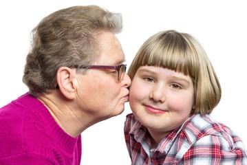 Grandmother kisses grandchild on cheek
