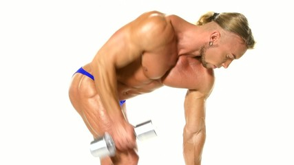 Young athlete trains silver dumbbells