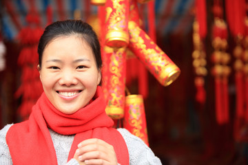 young asian woman wishing you a happy chinese new year
