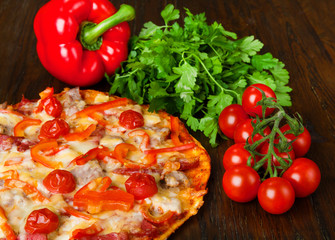 Delicious pizza with bacon and cherry tomatoes