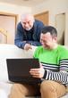 men  at work on laptop