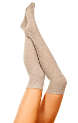 Female legs in knitted socks, white background, isolated