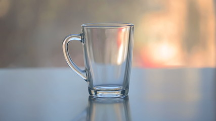 hot water over tea in transparent glass cup