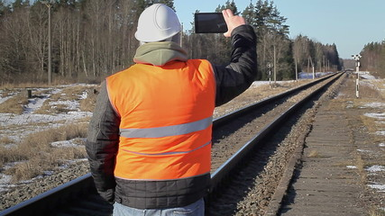 Railway employee filmed with tablet PC on the railway