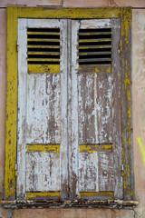 The window of old house with shutting shutters