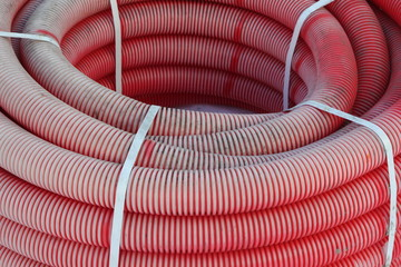 Red plastic tubes in the warehouse