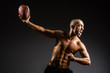 canvas print picture - Muscular football player with ball