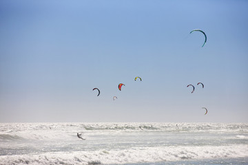 Kite surfers at sea
