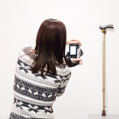 Female photographer taking pictures of the walking stick
