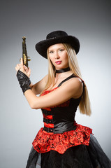 Woman pirate with gun wearing hat