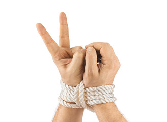 Bound hands and victory sign