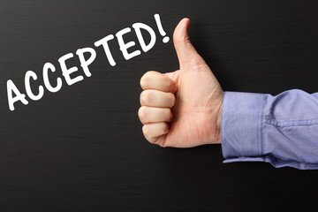 Thumbs Up for the word Accepted on a blackboard