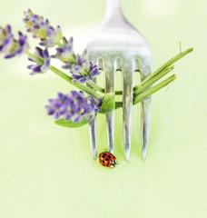 Ladybug on fork with lavender, table decoration