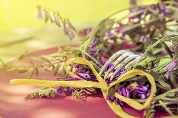 table decoration with vetch flowers and green cloth