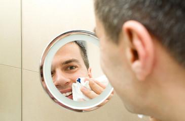 Male face in mirror