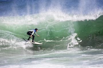 Surfer riding large wave