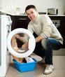 guy using washing machine