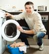 guy loading the washing machine