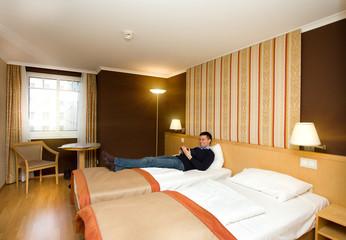 Man lying in hotel room