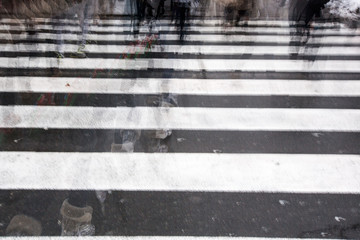 People crossing a road, blurred, in motion