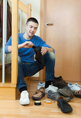 man  with shoes at home