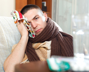 guy in plaid and scarf stuping  towel to head