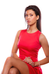 Girl mixed race in red dress posing