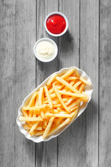 Aerial Shot of French Fries with Dipping Sauces