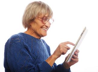 Senior happy woman using ipad