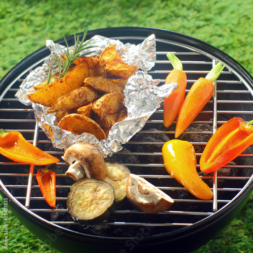 Fresh vegetables grilling over a BBQ fire - 78407535