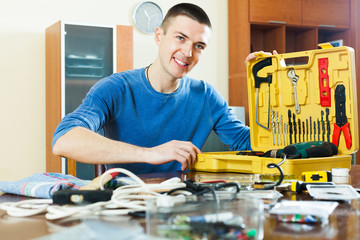 Smilng happy guy showing toolbox