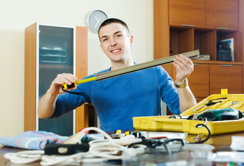 Happy man doing something with  tools