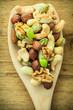 canvas print picture - Varieties of nuts: cashew, pistachio, almond.