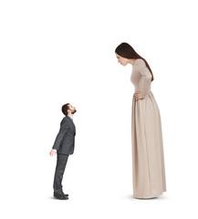 woman in long dress staring at man