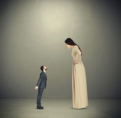 woman staring at small kissing man