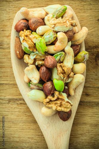 canvas print picture Varieties of nuts: cashew, pistachio, almond.