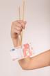 female hand with chopsticks