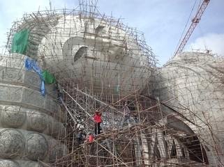 scaffold around buddha image