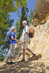 Portrait of senior couple on mountain path