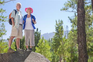 Portrait of senior couple on mountain path