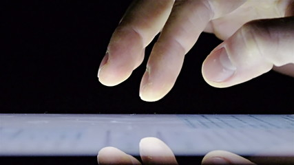 Tablet touchscreen, on black background
