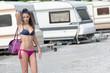 Athetic woman in caravan parking