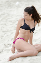 Sexy athletic women in bikini and horsetail hairstyle